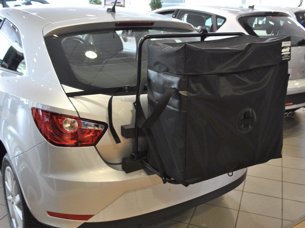 seat Ibiza roof box hatch-bag fitted to a silver seat ibiza in a seat showroom