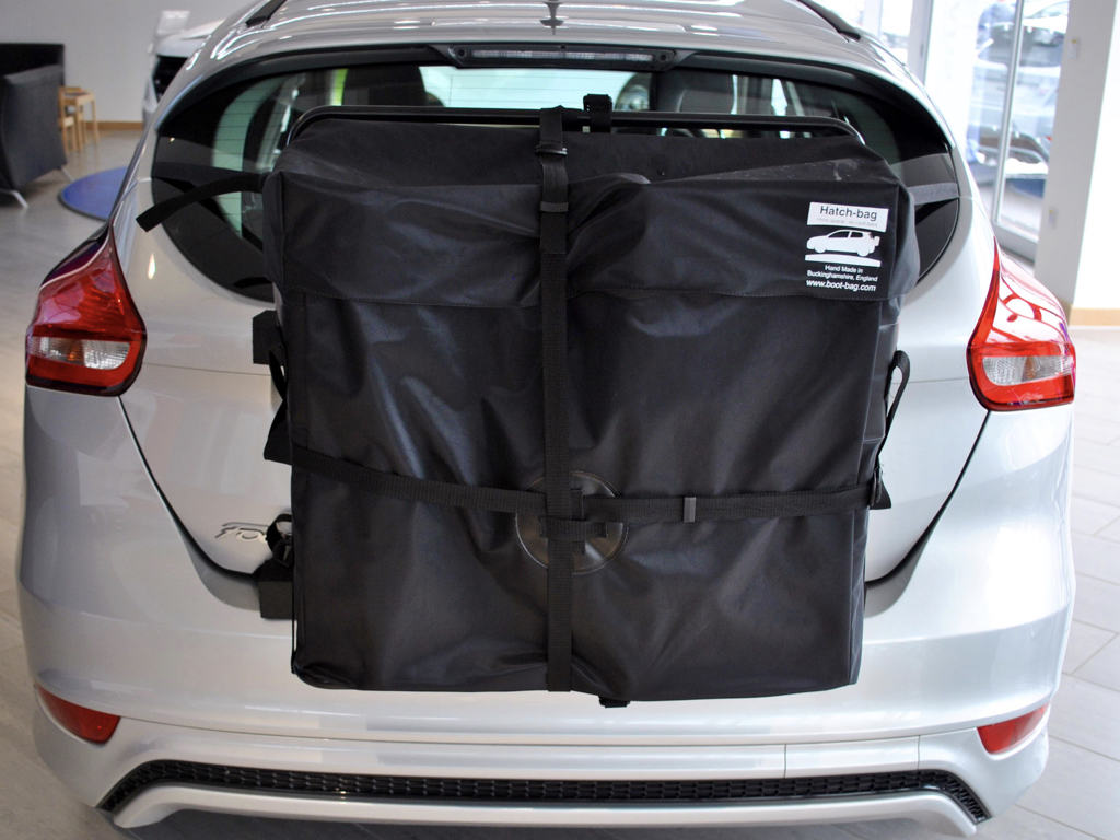 silver 2015 ford focus with a hatch-bag roof box alternative fitted