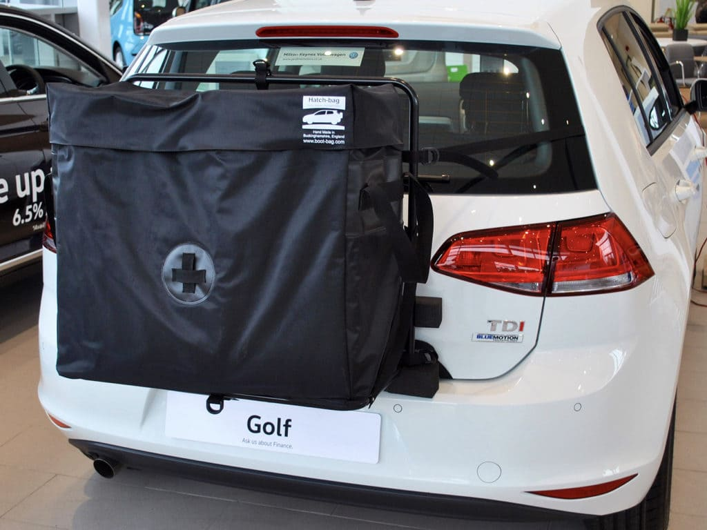 Golf convertible luggage rack hatch-bag fitted to a white vw golf