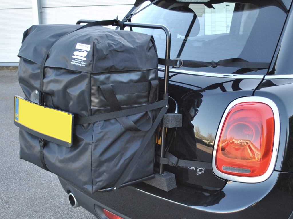 hatch-bag mini roof box alternative fitted to a black 5 door mini cooper photographed from the side