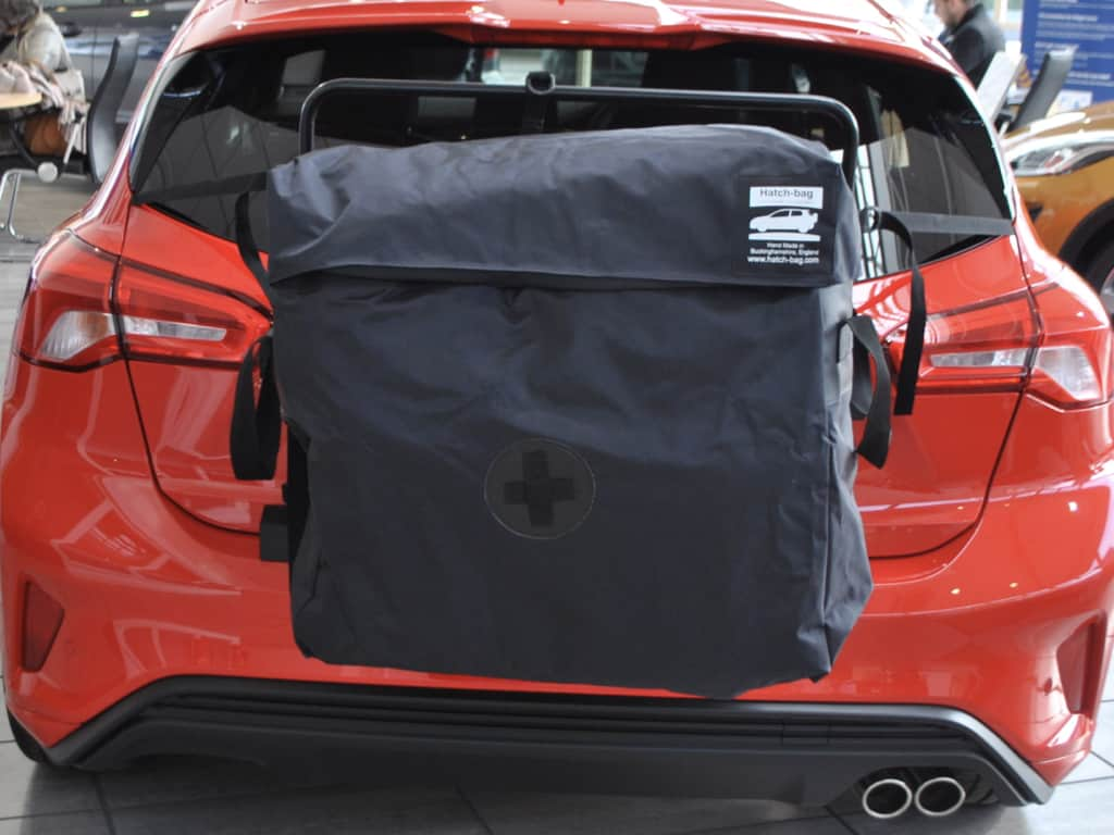 red ford focus with a hatch-bag roof rack or roof box alternative fitted to it