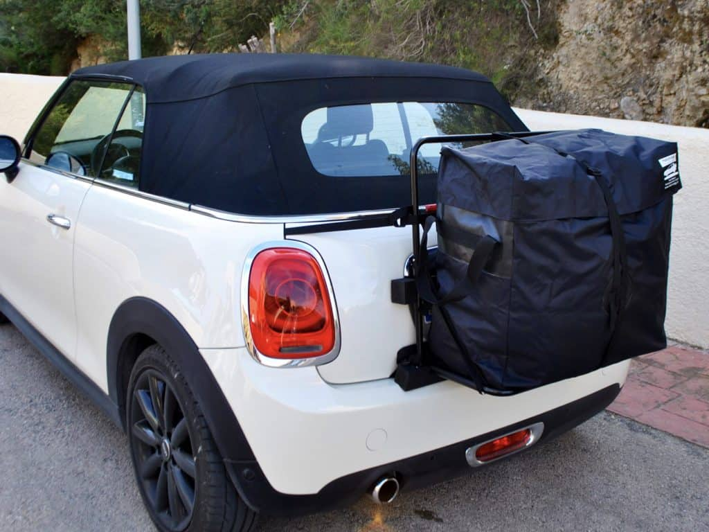 white mini cooper convertible with a hatchbag luggage carrier rack fitted